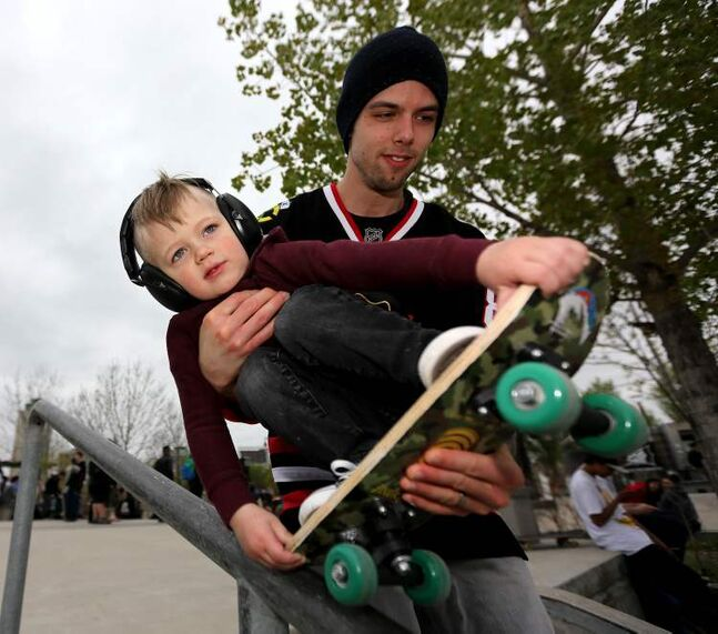 Cruz Friesen, 2, and his dad Dylan practice some moves at the skatepark at The Forks during the Skate4Cancer event Saturday.