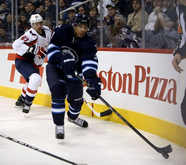 Winnipeg Jets' Evander Kane carries the puck in front of Washington Capitals' Jay Beagle during the second period of Saturday's game.