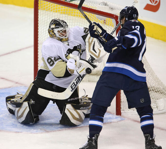 Pittsburgh Penguins' goaltender Tomas Vokoun (92) stops Winnipeg Jets' Kyle Wellwood (13) in front of the Pittsburgh net during the second period of play at MTS Centre, Friday, January 25, 2013. (TREVOR HAGAN/WINNIPEG FREE PRESS)