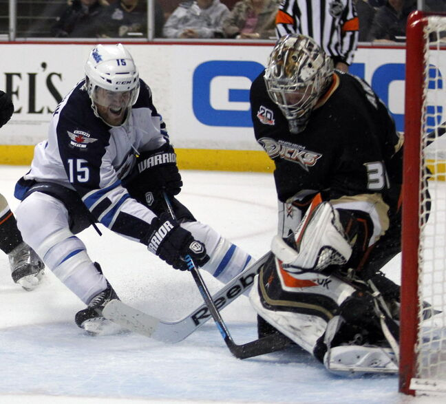 Winnipeg Jets' right wing Matt Halischuk (15) scores on Anaheim Ducks' goalie Frederik Andersen, right, in the first period of Monday's game in Anaheim.