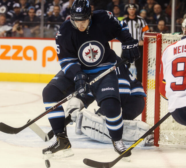 Winnipeg Jets rookie defenceman Zach Redmond eyes the puck close to the Jets' goal during the first period at MTS Centre Tuesday night.