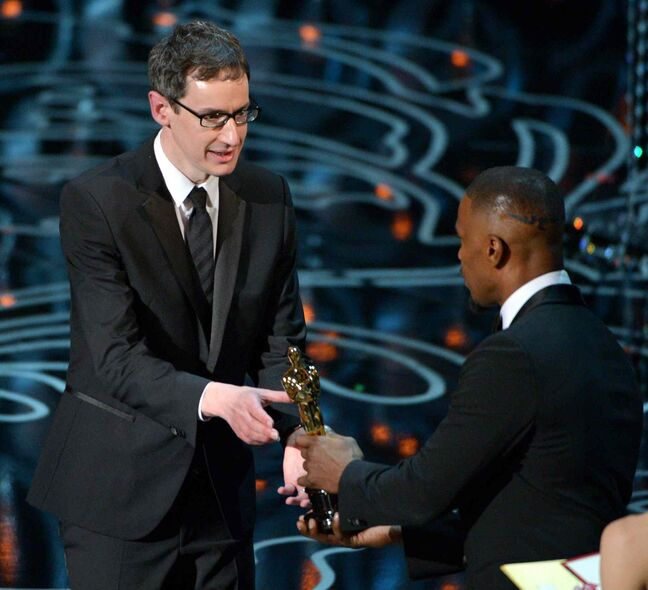 Jamie Foxx, right, presents Steven Price with the Academy Award for original score in a feature film for Gravity during the Oscars.