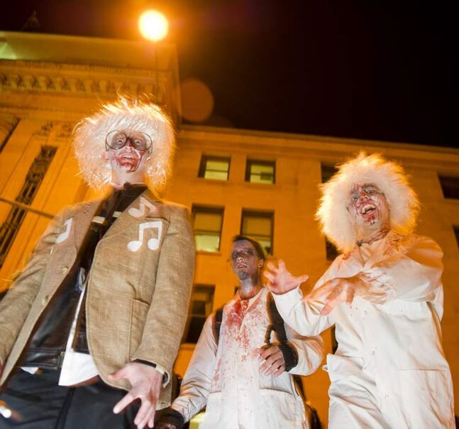 Participants in the annual Winnipeg Zombie Walk from The Forks to The Manitoba Legislative Building Saturday night.  DAVID LIPNOWSKI / WINNIPEG FREE PRESS