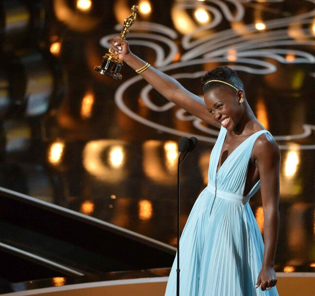 Lupita Nyong'o accepts the Academy Award for best actress in a supporting role for 12 Years a Slave.