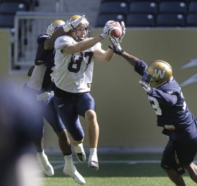 Winnipeg Blue Bomber slot back #87 Rory Kohlert catches a pass with close coverage at practice on Investors Group Field Thursday. Wayne Glowacki / Winnipeg Free Press