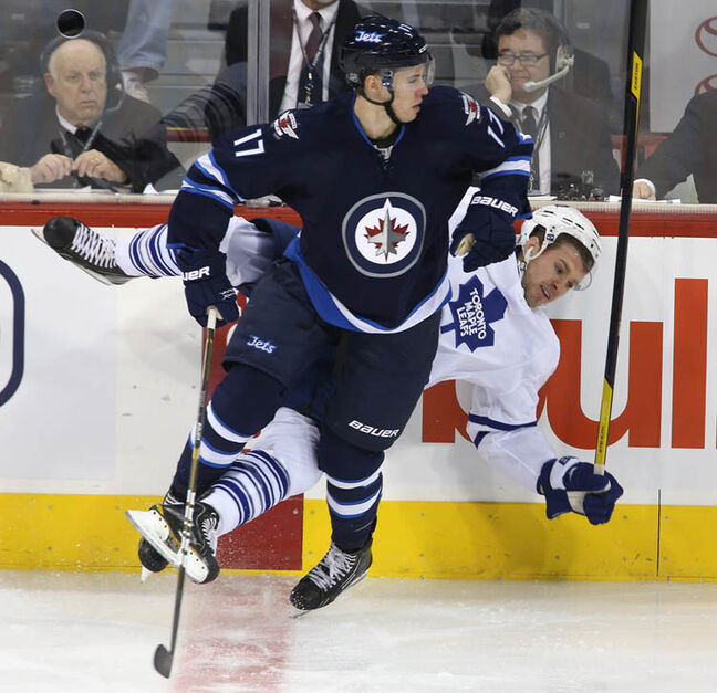 Winnipeg Jets' James Wright hits Toronto Maple Leafs' Cody Franson during the first period at MTS Centre in Winnipeg on Thursday.