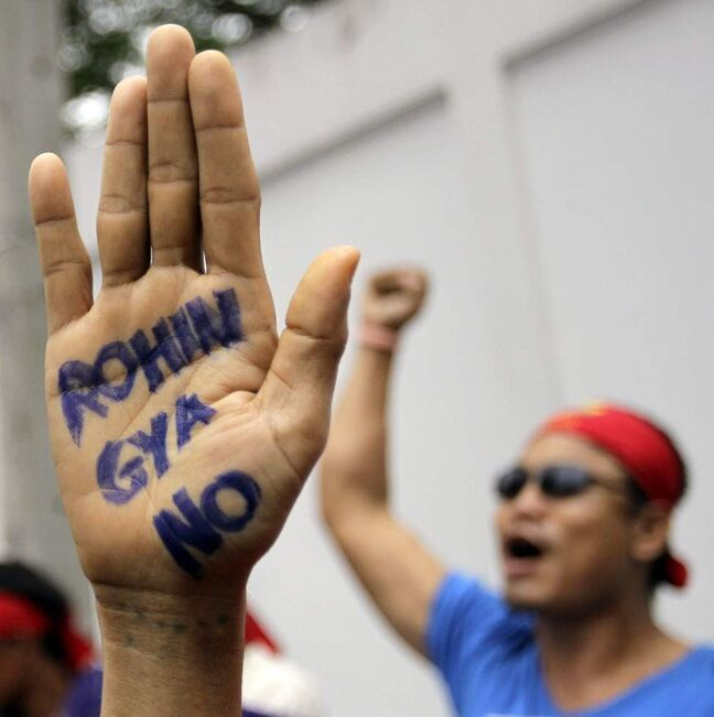 A Buddhist monk shows a message written in his palm to protest against the ethnic minority Rohingyas in Myanmar during a visit of Myanmar's President Thein Sein in Bangkok, Thailand. Communal violence is grinding on in western Myanmar six weeks after the government declared a state of emergency there, and Muslim Rohingyas are increasingly being hit with targeted attacks that have included killings, rape and physical abuse, Amnesty International said last week. (AP Photo/Sakchai Lalit)