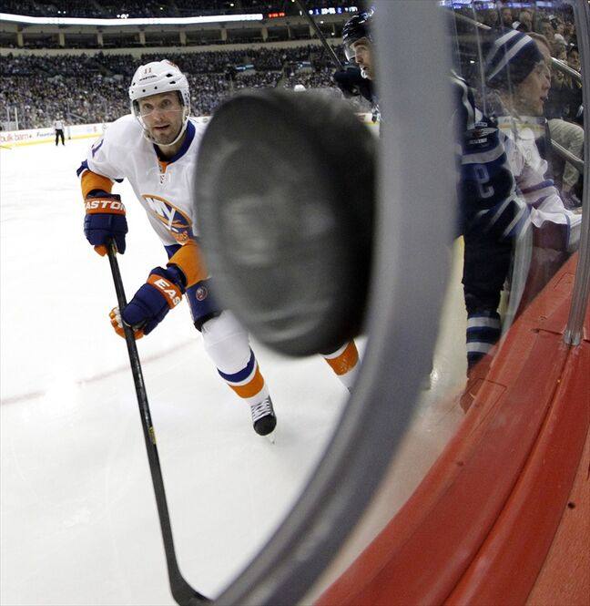 New York Islanders' Lubomir Visnovsky looks on as the puck nearly pokes through the photographers hole at the MTS Centre during the second period.