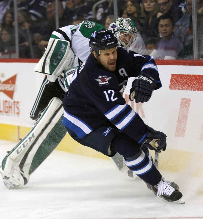 Olli Jokinen gets tied up with Dallas Stars goaltender Kari Lehtonen during the second period.