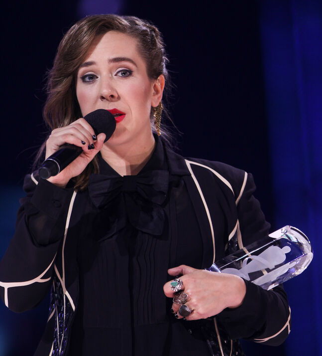 Serena Ryder reacts after winning songwriter of the year at the 2014 Juno Awards.