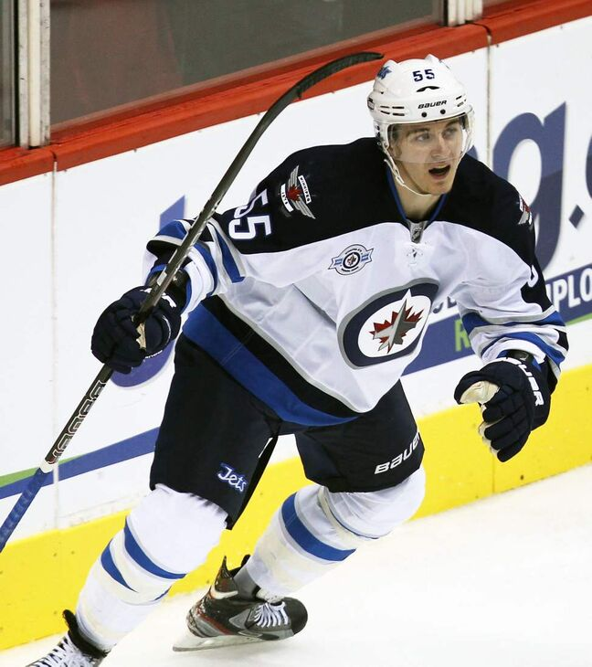 Winnipeg Jets' Mark Scheifele celebrates his teammate Andrew Ladd's second period goal during a game against the Phoenix Coyotes Saturday night at Jobing.com Arena in Glendale, Arizona.  The Coyotes beat the Winnipeg Jets 4-1.   (JOE BRYKSA / WINNIPEG FREE PRESS)