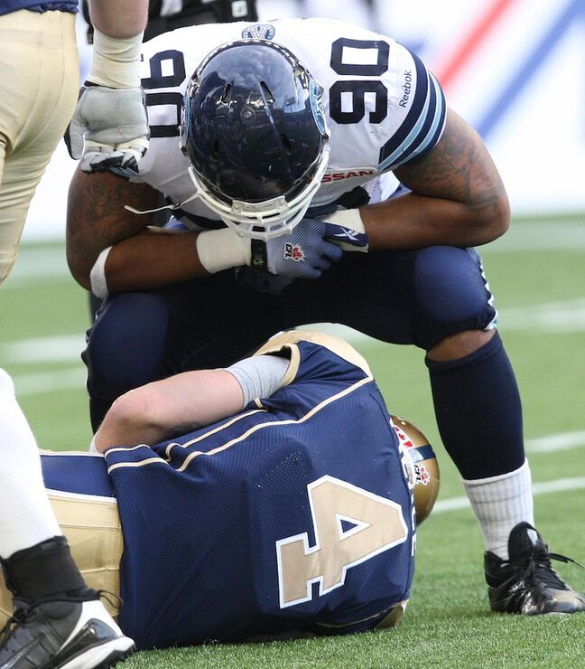 Cleyon Lang of the Toronto Argonauts taunts Winnipeg Blue Bombers quarterback Buck Pierce after Pierce was sacked late in the second quarter during Friday night's game.