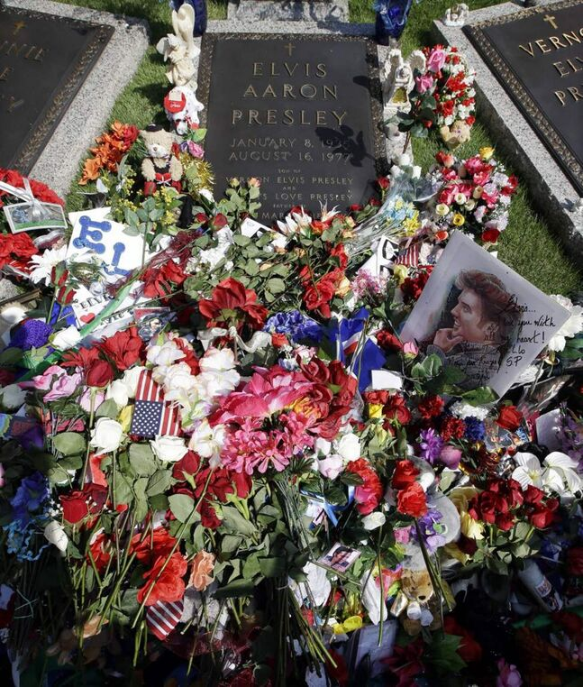 Flowers left by fans decorate the grave of Elvis Presley at Graceland, Presley's Memphis, Tenn. home. Fans from around the world are at Graceland to commemorate the 35th anniversary of Presley's death. Presley died Aug. 16, 1977. (AP Photo/Mark Humphrey)