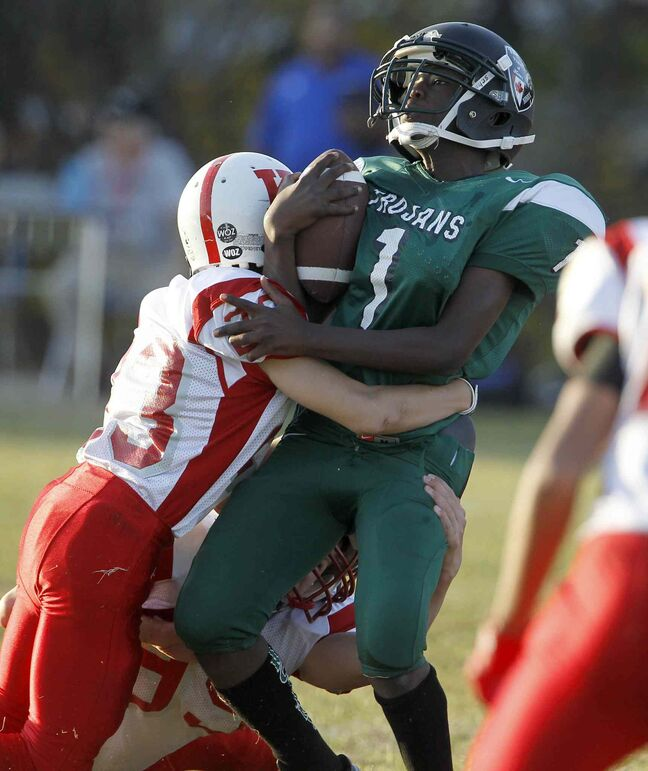 Kelvin Clippers Junho Yoo tackles Evans Sylvestre of the Vincent Massey Trojans.