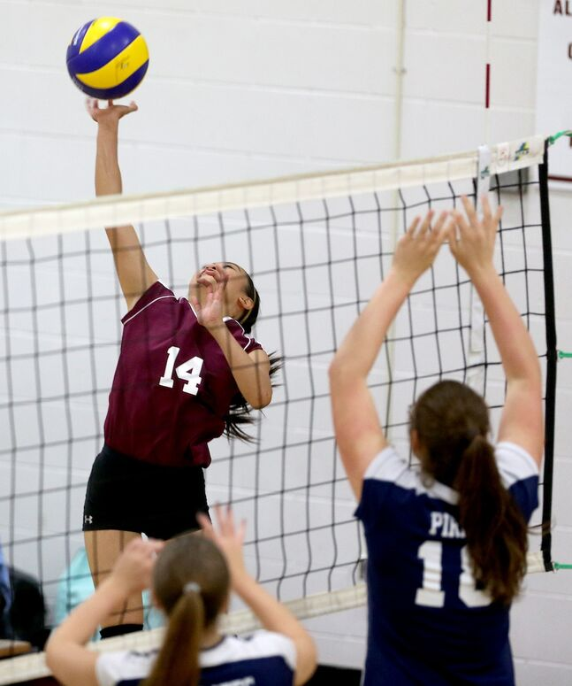 DMCI Maroons' Charisse Ahmad jumps to hit the ball.