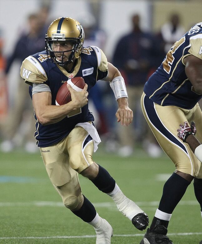Winnipeg Blue Bombers quarterback Buck Pierce scrambles with the ball during the third quarter.