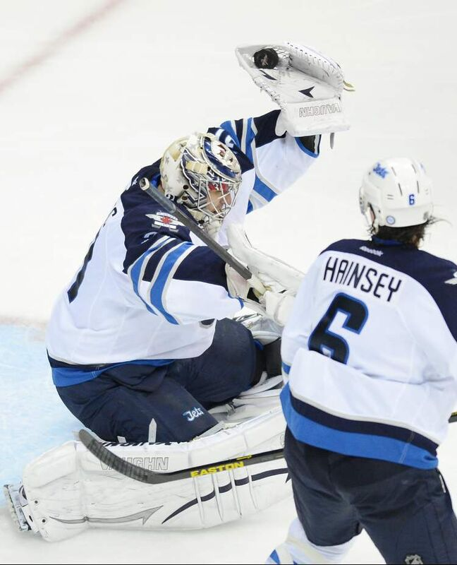 Winnipeg Jets goalie Ondrej Pavelec flashes the leather against the Washington Capitals in the third period.