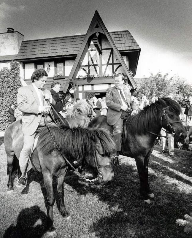 Mayor Davíð Oddson of Reykjavík, Iceland and Mayor Bill Norrie mount Icelandic horses at a reception held at the Round Table restaurant. Undated