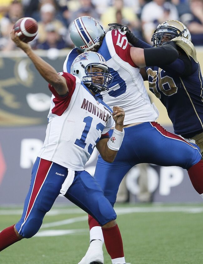 Montreal Alouettes quarterback Anthony Calvillo (13) throws against the Winnipeg Blue Bombers during the first half.