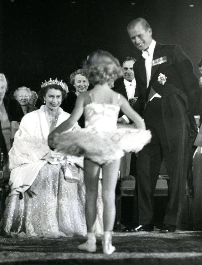 Queen Elizabeth watches a little one dance during her 1952 visit to Winnipeg.