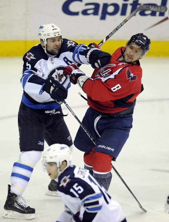 Winnipeg Jets defenceman Mark Stuart tangles with Washington Capitals left-winger Alex Ovechkin during the third period.
