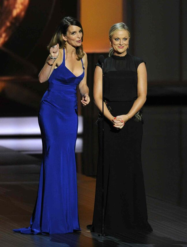 Tina Fey, left, and Amy Poehler present the award for outstanding supporting actress in a comedy series. Merritt Wever of Nurse Jackie won the night's first award, for best supporting actress in a comedy series, kicking off the ceremony on a surprising note and with a remarkably brief acceptance speech.