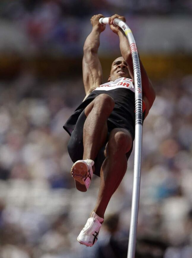 Canada's Damian Warner competes in the men's decathlon pole vault in the Olympic Stadium at the 2012 Summer Olympics. (AP Photo/Matt Slocum)