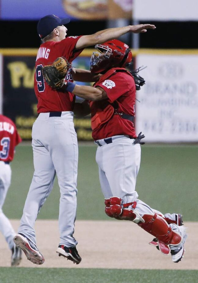 Winnipeg Goldeyes pitcher Brian Beuning, left, celebrates with catcher Luis Alen after defeating the Wichita Wingnuts 8-3 in Wichita, Kansas Friday night.