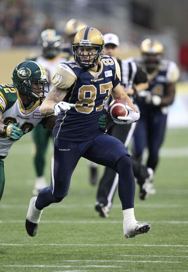 Rory Kohlert heads towards the end zone as Joe Burnett of the Edmonton Eskimos gives chase during the first half. Kohlert made it near to the goal line, setting up a Bomber touchdown.