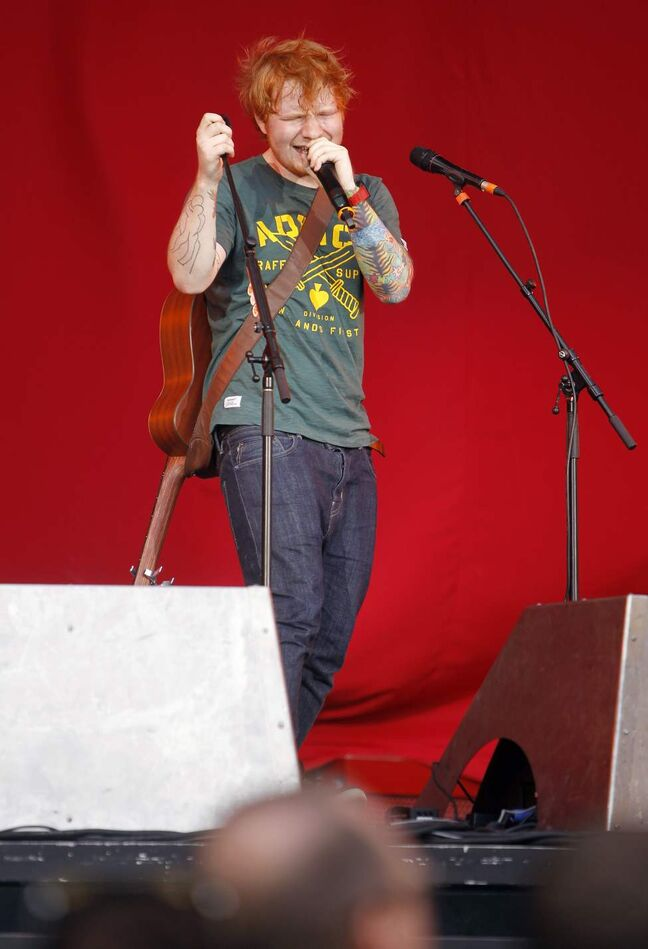 British singer-songwriter Ed Sheeran opens for Taylor Swift at Investors Group Field, Saturday, June 22, 2013.