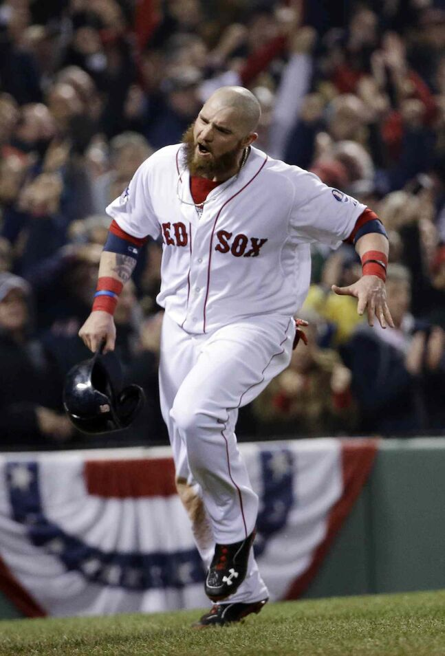 Boston Red Sox's Jonny Gomes reacts after scoring during the third inning.