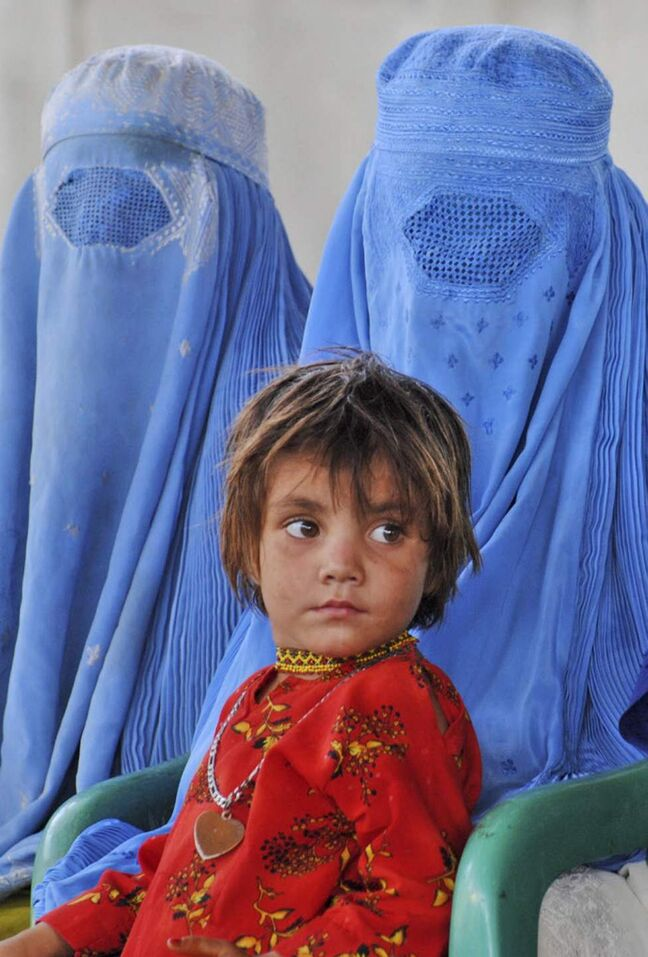 Afghan refugees wait for transport to go to Afghanistan at a repatriation centre run by the United Nations High Commissioner for Refugees, on World Refugee Day, in Peshawar, Pakistan. World Refugee Day, a day initiated by the United Nations to raise awareness on the plight of refugees worldwide, is observed on June 20 every year. (AP Photo/Mohammad Sajjad)