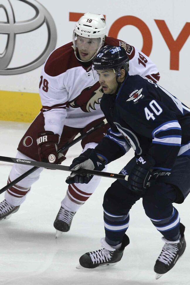 Winnipeg Jets' Devin Setoguchi (40) and Phoenix Coyotes' Shane Doan (19) stay alert during the second period.