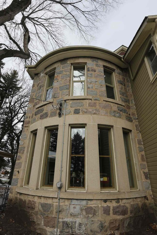 A stone turret faces into the backyard.