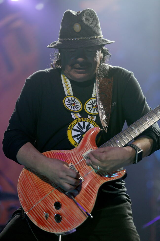 Santana shows off his guitar skills.