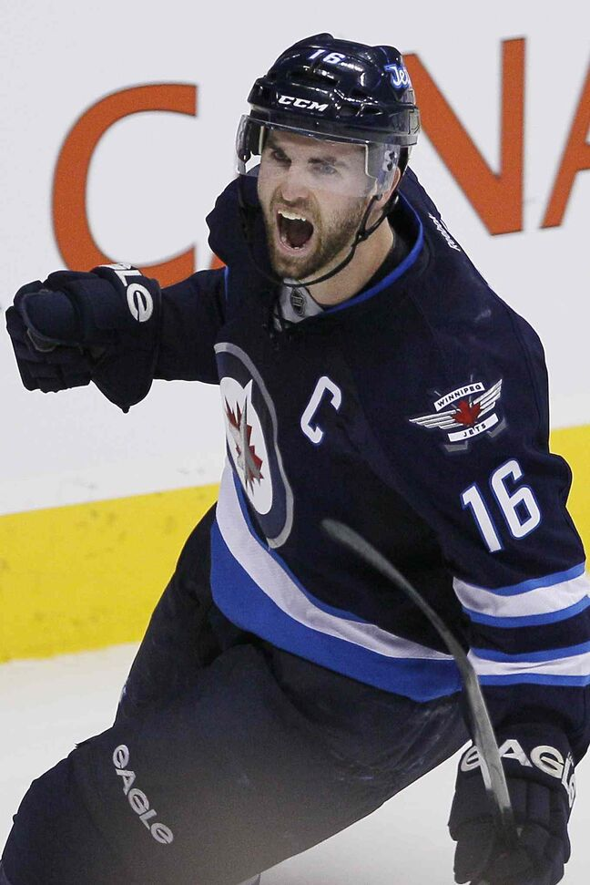 Andrew Ladd celebrates his shootout goal.