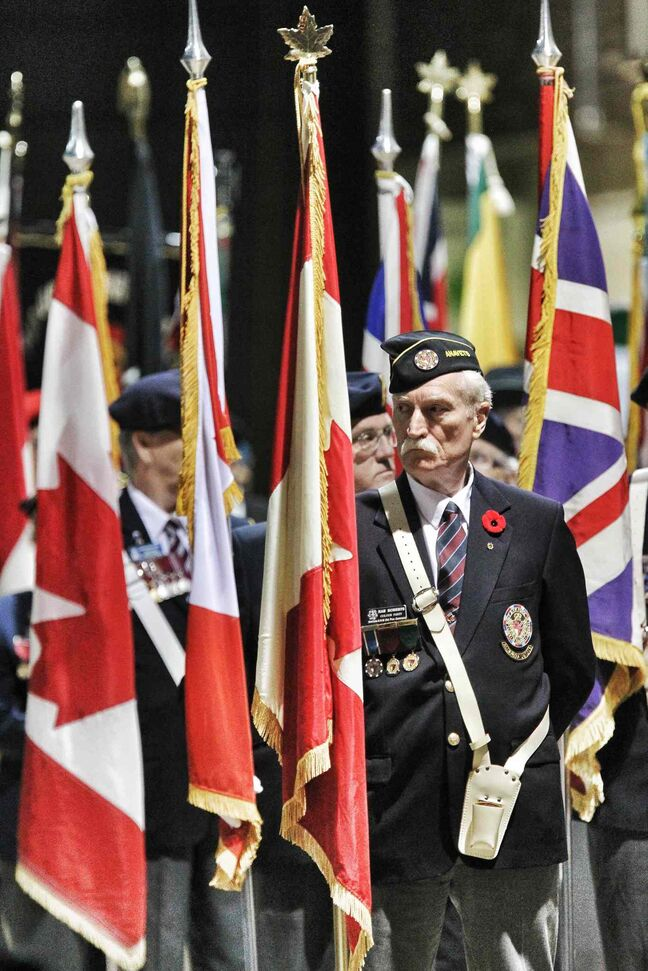 Rae Roberts of the Manitoba and Northwest Ontario Provincial Command Colour Party stands at the ready prior to the start of the Remembrance Day ceremony at the RBC Convention Winnipeg.
