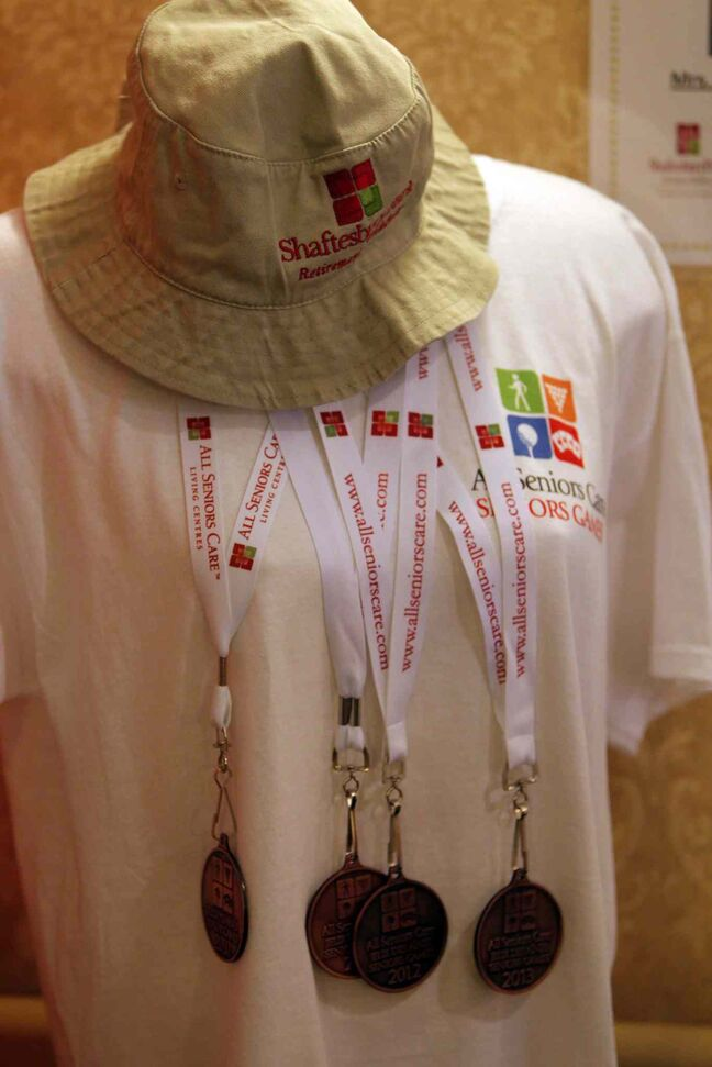 Medals a T-shirt and hat are on display at the All Senior Care Senior Games 2014 at Shaftesbury Park Retirement Residence.