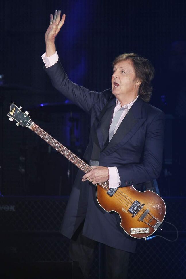 Paul McCartney waves to the crowd.