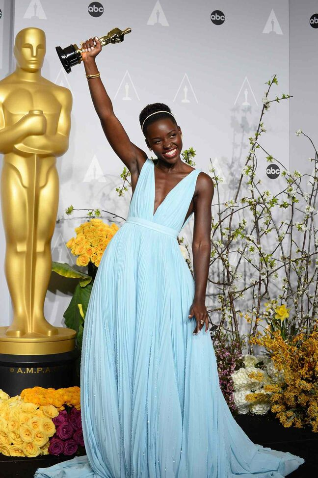 Lupita Nyong'o with her Academy Award for best actress in a supporting role for 12 Years a Slave.