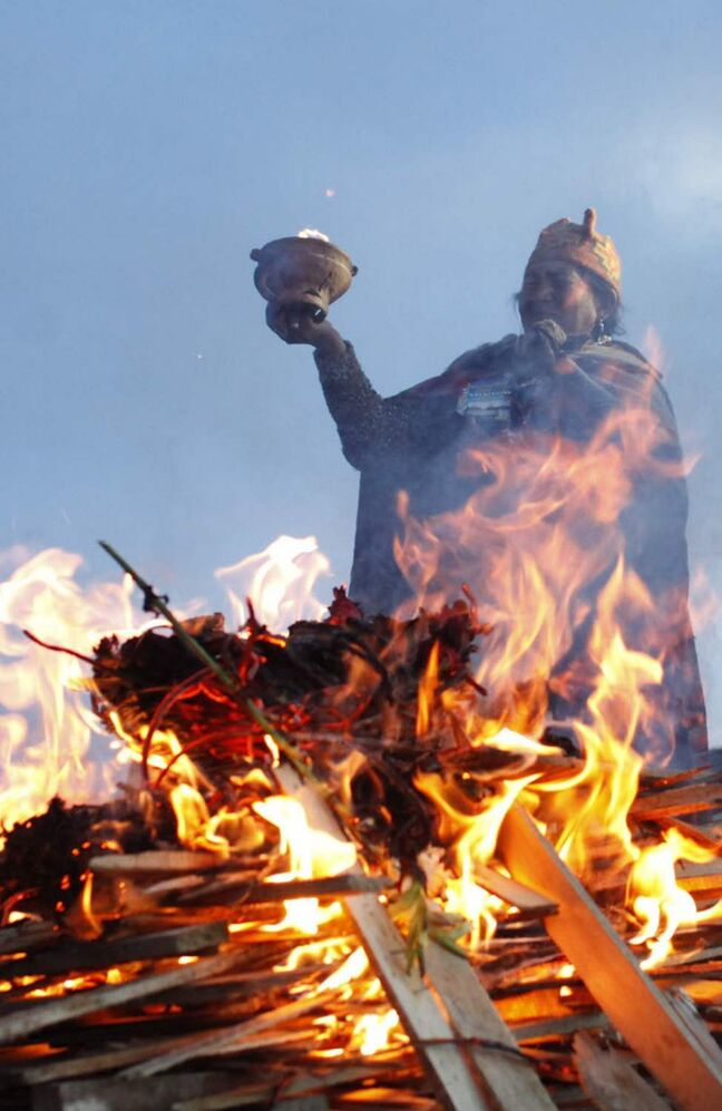 An Andean religious leader performs a new years' ritual at the ruins from the ancient civilization of Tiwanaku, on the highlands in Tiwanaku, Bolivia. The Aymara Indians celebrate the year 5,520 as well as the southern hemisphere's winter solstice, marking the start of a new agricultural cycle. (AP Photo/Juan Karita)