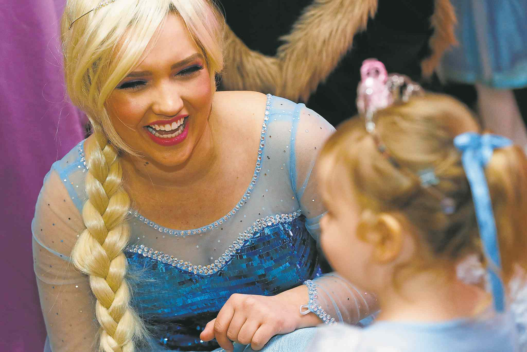 Queen Elsa talks to a young princess at the first annual Royal Princess Ball.