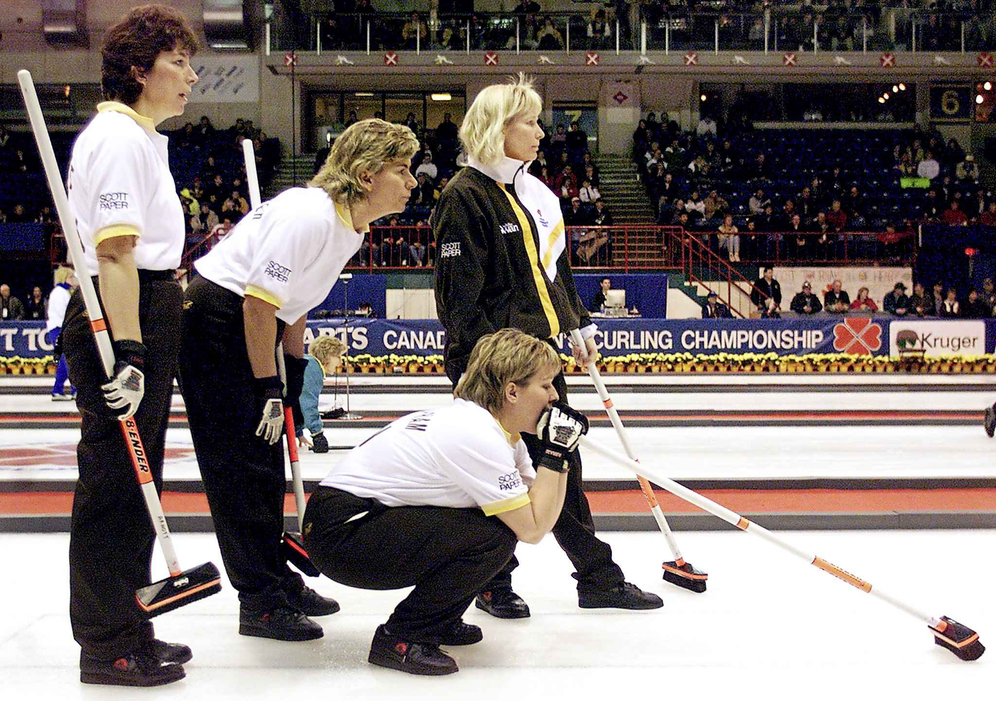 In Charlottetown in February 1999,  Janet Arnott (left) was lead of the Manitoba rink  that included Debbie Jones-Walker (second), Connie Lalibertie (skip) and Cathy Overton-Clapham (third, crouching) at the Scott Tournament of Hearts.