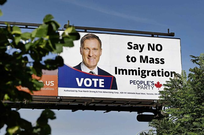 A billboard featuring the portrait of People's Party of Canada (PPC) leader Maxime Bernier and its message