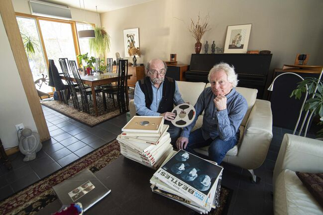 Michael Gillespie (left) and Dan Donahue (right) with Gillespie's collection of Beatles vinyl and reels from the radio program, The Story of the Beatles, which originally aired on Toronto radio station CHUM in 1970.