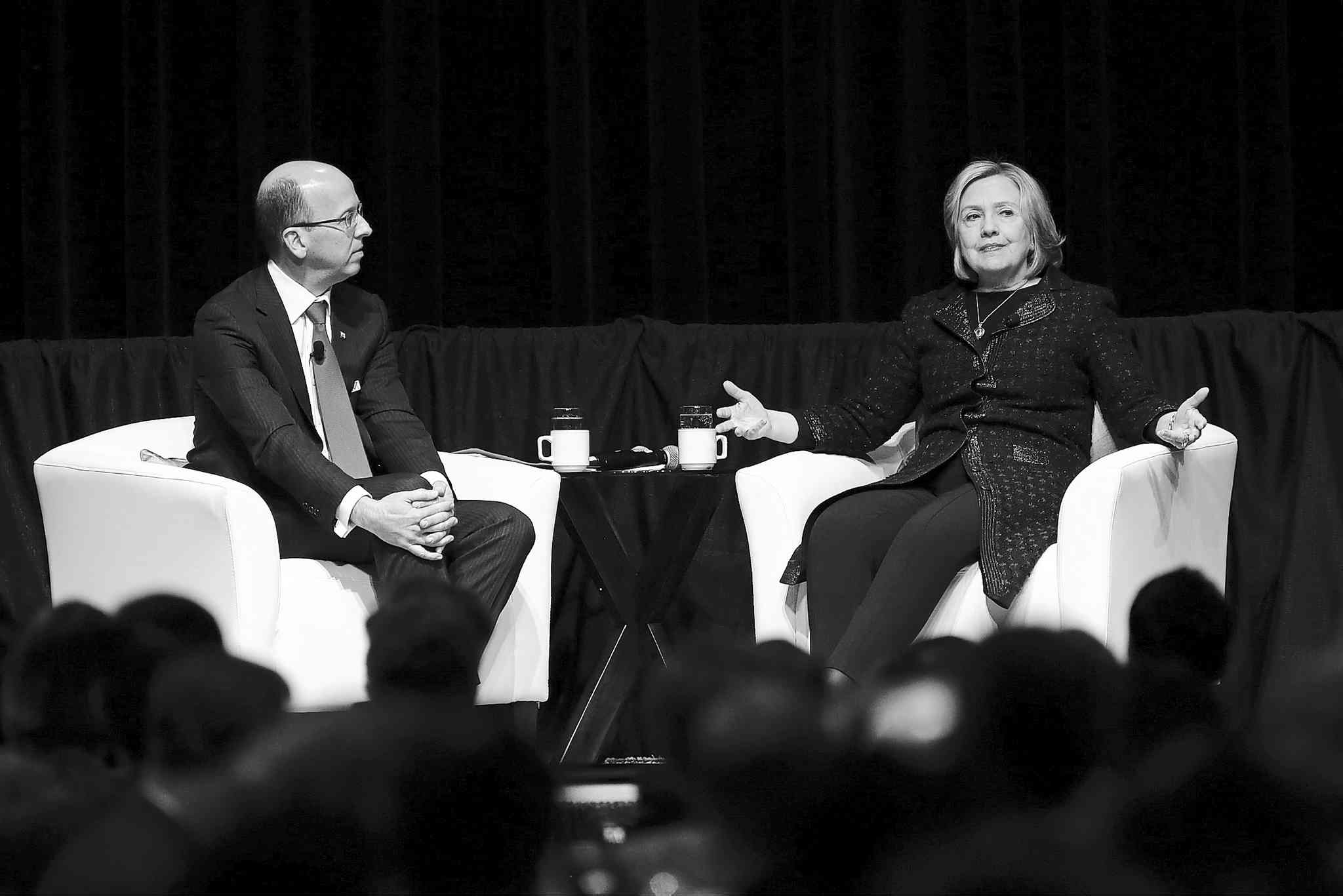 Former U.S. secretary of state Hillary Rodham Clinton speaks with CIBC CEO Victor Dodig in Winnipeg Wednesday.