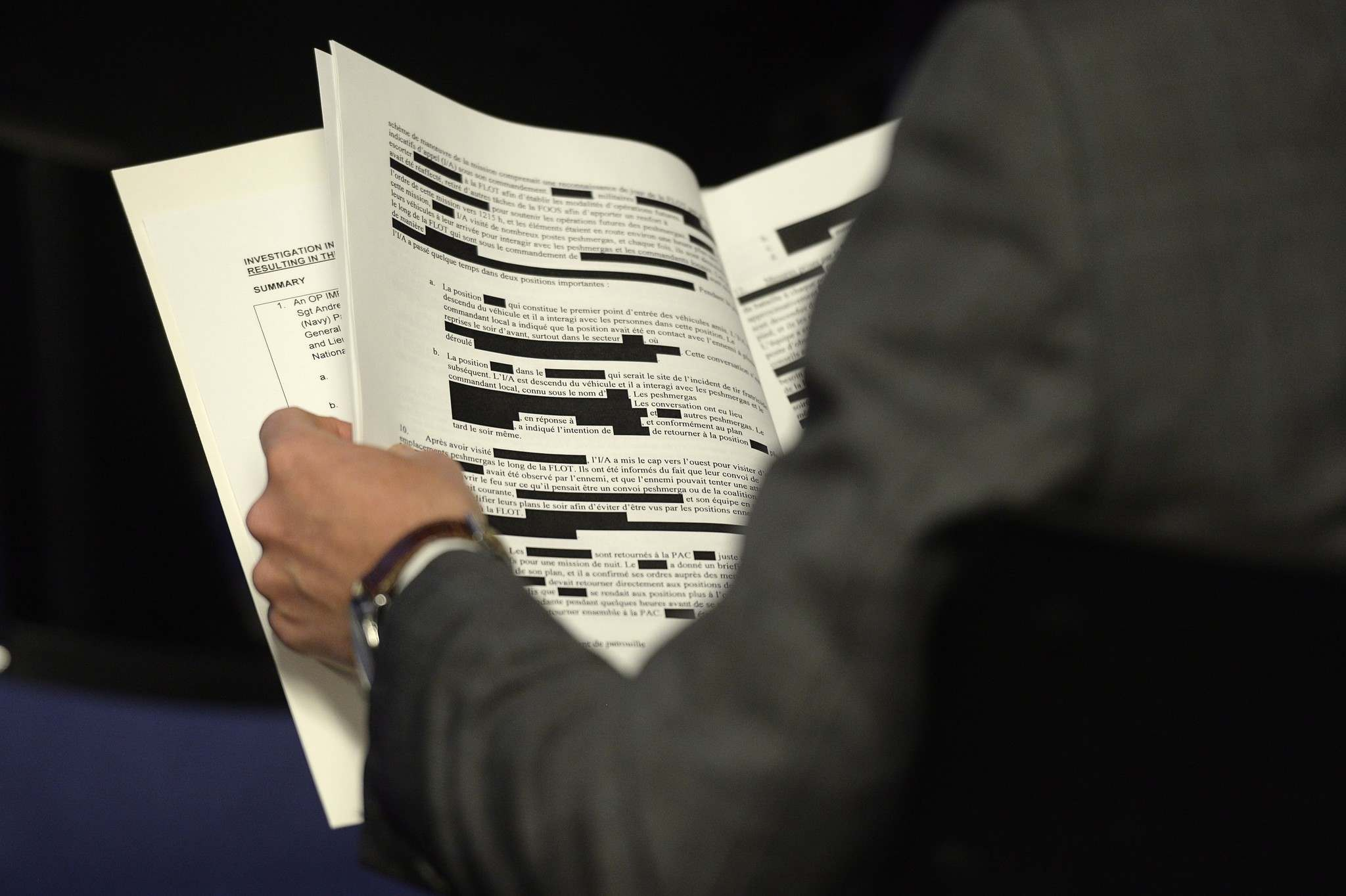 ADRIAN WYLD /THE CANADIAN PRESS files</p><p>A reporter holds a redacted copy of a report on a friendly-fire incident. The control of information at both levels of government is a serious issue for democracy. </p>
