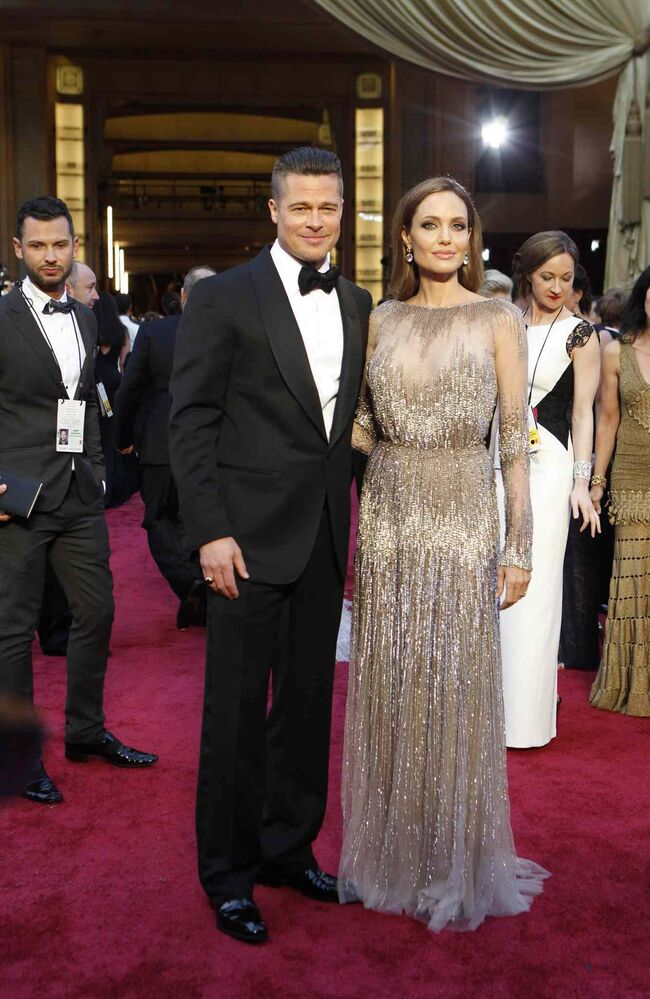 Angelina Jolie and Brad Pitt arrive at the 86th annual Academy Awards at the Dolby Theatre at Hollywood & Highland Center in Los Angeles.  (Wally Skalij / Tribune Media MCT)