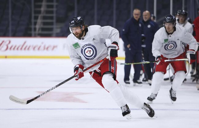 Jets captain Blake Wheeler skates with teammate Mark Scheifele trailing during practice at Bell MTS Place. (Ruth Bonneville / Winnipeg Free Press files)