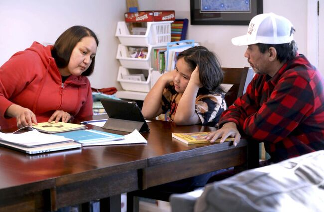 Carter Parenteau, in grade 4, does schoolwork at his home in Silver Heights with his parents, Anna and Jason Parenteau.</p>